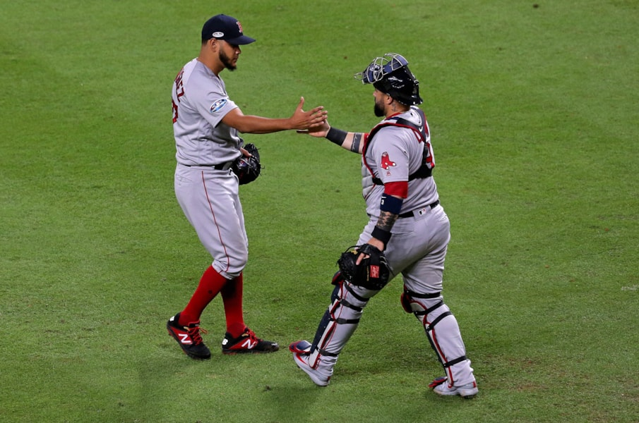 Oct 16, 2018; Houston, TX, USA; Boston Red Sox relief pitcher Eduardo Rodriguez (57) and catcher Sandy Leon (3) celebrate after defeating the Houston Astros in game three of the 2018 ALCS playoff baseball series at Minute Maid Park. Mandatory Credit: Thomas B. Shea-USA TODAY Sports