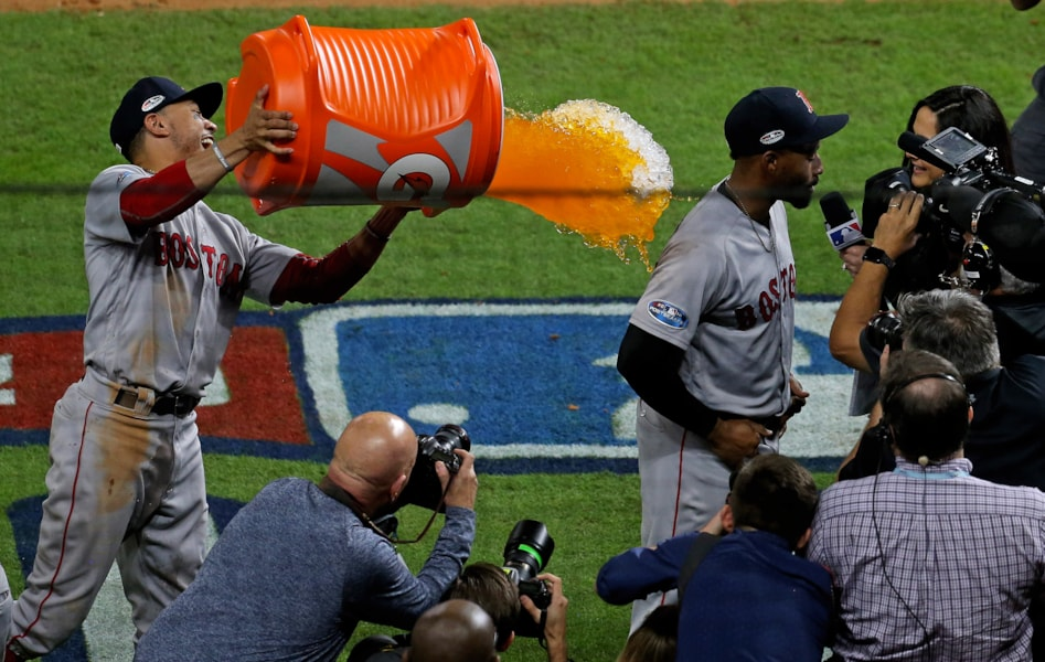 Oct 16, 2018; Houston, TX, USA; Boston Red Sox right fielder Mookie Betts (50) douses center fielder Jackie Bradley Jr. (19) with gatorade after defeating the Houston Astros in game three of the 2018 ALCS playoff baseball series at Minute Maid Park. Mandatory Credit: Thomas B. Shea-USA TODAY Sports