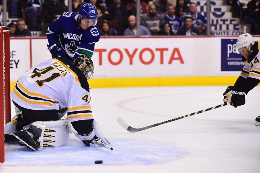 Oct 20, 2018; Vancouver, British Columbia, CAN; Vancouver Canucks forward Bo Horvat (53) shoots the puck in front of Boston Bruins goaltender Jaroslav Halak (41) and defenseman Steven Kampfer (44) during the first period at Rogers Arena. Mandatory Credit: Anne-Marie Sorvin-USA TODAY Sports