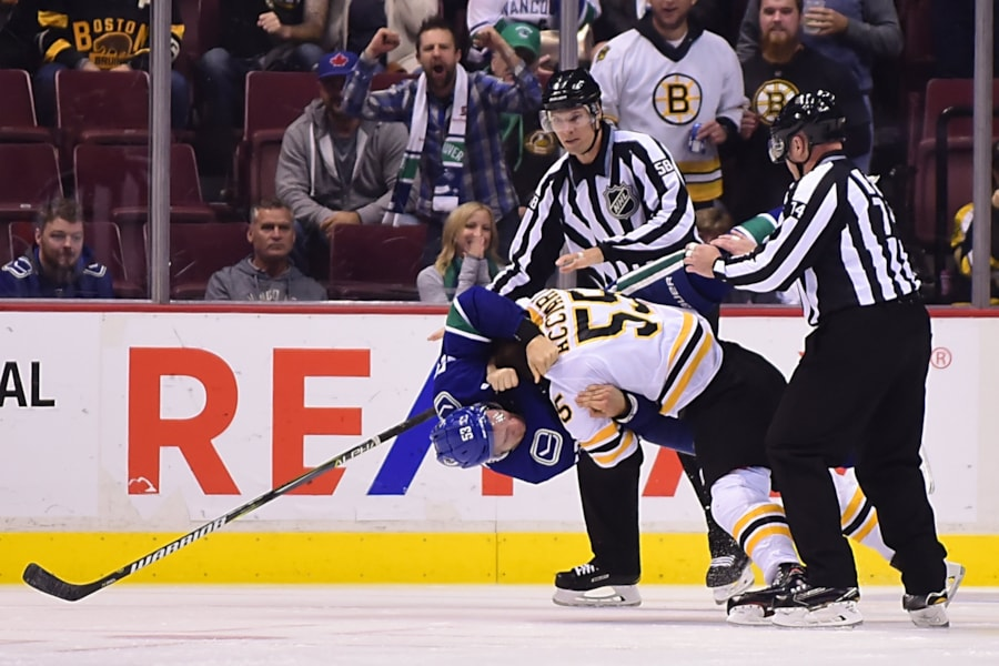 Oct 20, 2018; Vancouver, British Columbia, CAN; Boston Bruins forward Noel Acciari (55) fights Vancouver Canucks forward Bo Horvat (53) during the second period at Rogers Arena. Mandatory Credit: Anne-Marie Sorvin-USA TODAY Sports
