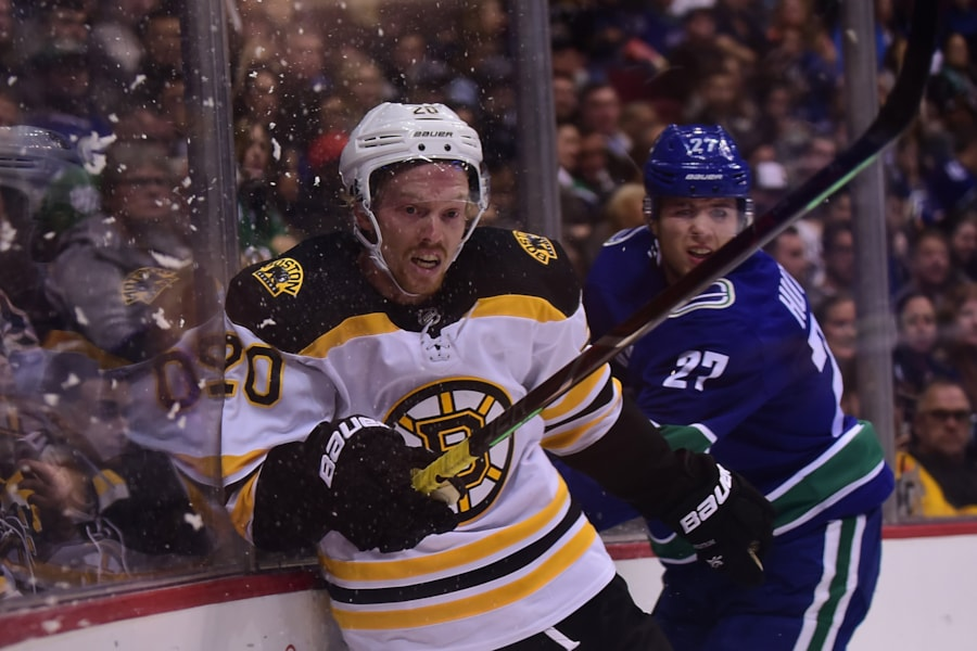 Oct 20, 2018; Vancouver, British Columbia, CAN; Vancouver Canucks defenseman Ben Hutton (27) checks Boston Bruins forward Joakim Nordstrom (20) into the boards during the second period at Rogers Arena. Mandatory Credit: Anne-Marie Sorvin-USA TODAY Sports