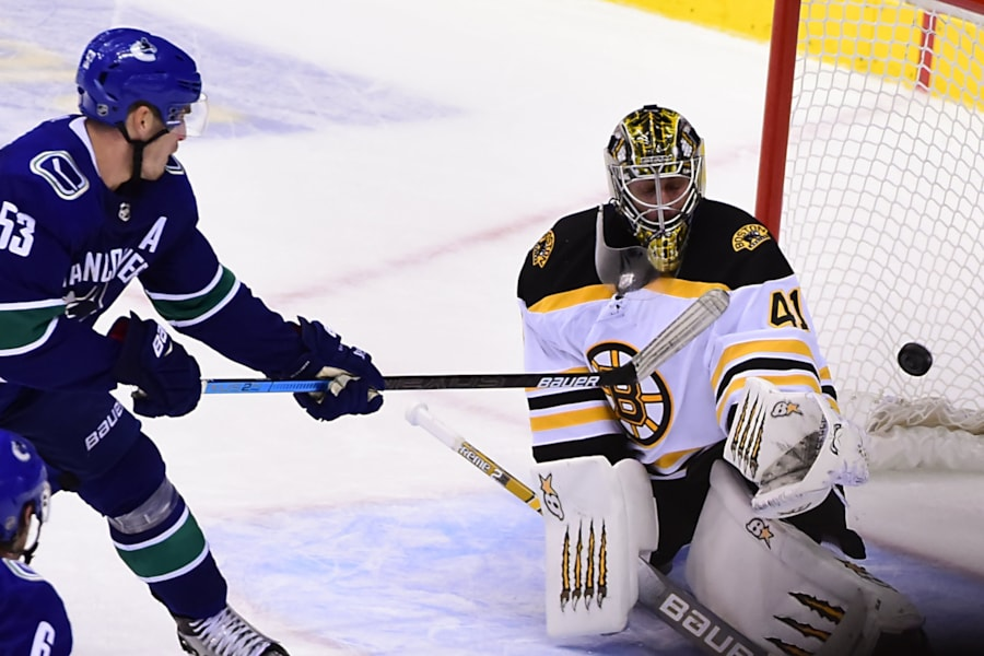 Oct 20, 2018; Vancouver, British Columbia, CAN; Vancouver Canucks forward Bo Horvat (53) scores a goal in overtime past Boston Bruins goaltender Jaroslav Halak (41) at Rogers Arena. Mandatory Credit: Anne-Marie Sorvin-USA TODAY Sports