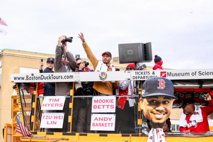 Oct 31, 2018; Boston, MA, USA; Boston Red Sox right fielder Mookie Betts (50) waves to the crowd during the victory parade to celebrate the Boston Red Sox World Series victory at Fenway Park. Mandatory Credit: Paul Rutherford-USA TODAY Sports
