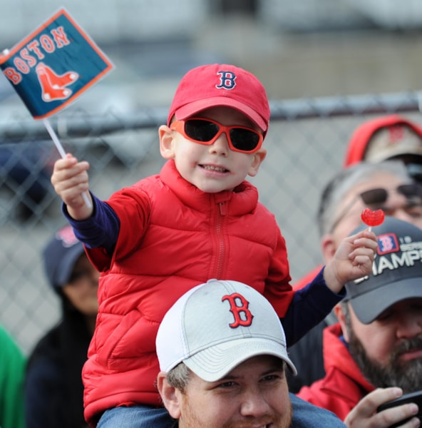 Oct 31, 2018; Boston, MA, USA; A young fan waves a flag prior to the Boston Red Sox 2018 World Series championship parade in Boston. Mandatory Credit: Bob DeChiara-USA TODAY Sports