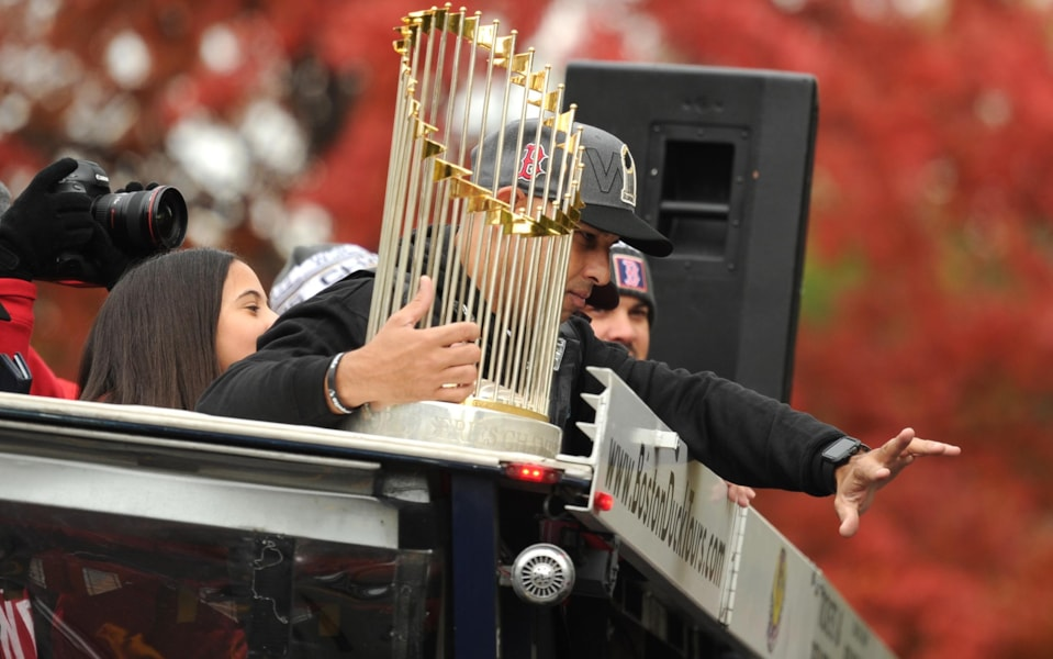 Oct 31, 2018; Boston, MA, USA; Boston Red Sox manager Alex Cora holds the Commissioner's Trophy during the 2018 World Series championship parade in Boston. Mandatory Credit: Bob DeChiara-USA TODAY Sports