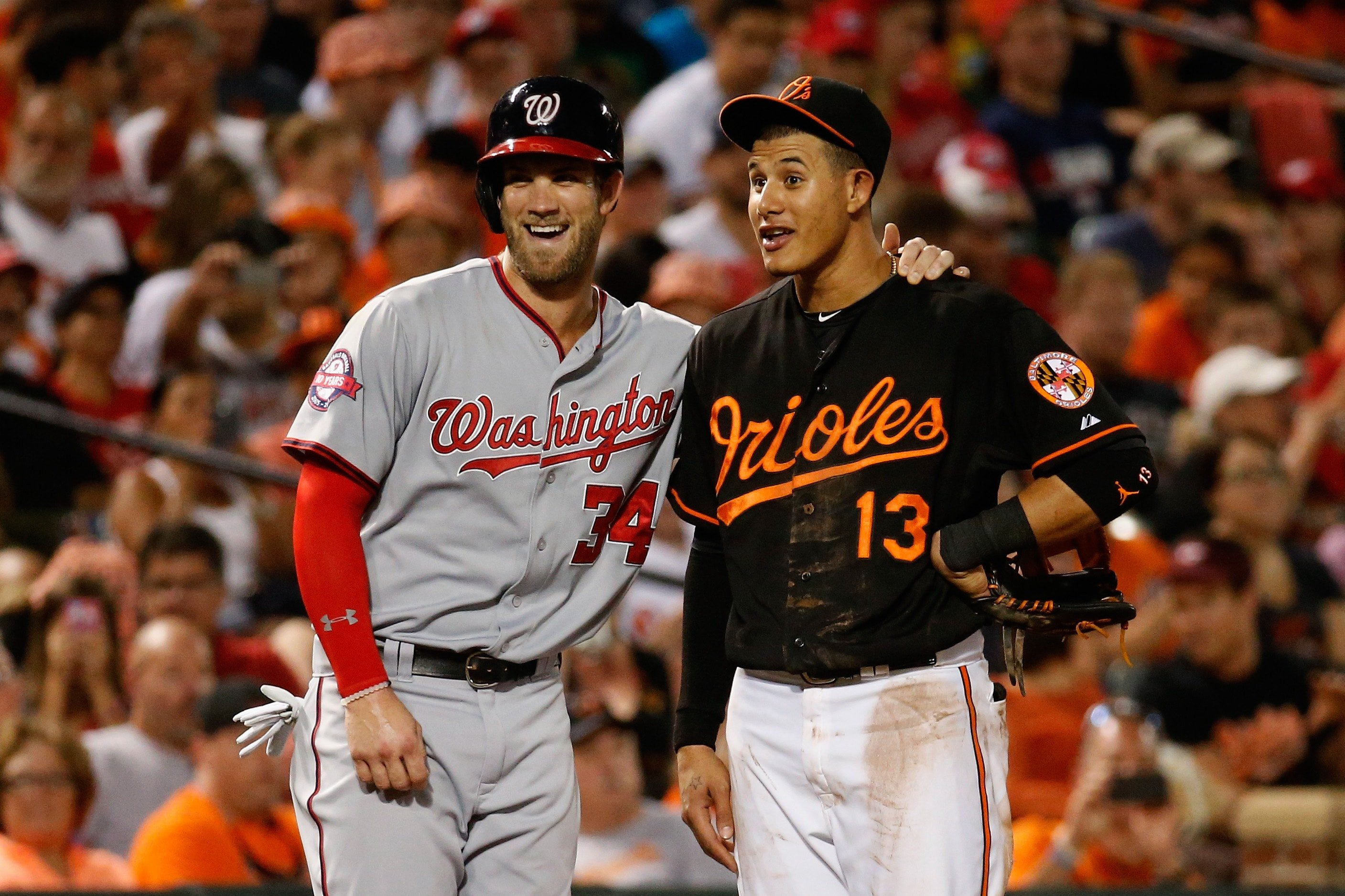 BALTIMORE, MD - JULY 10: Bryce Harper of the Washington Nationals and Manny Machado of the Baltimore Orioles talk during their game at Oriole Park at Camden Yards. (Photo by Rob Carr/Getty Images)