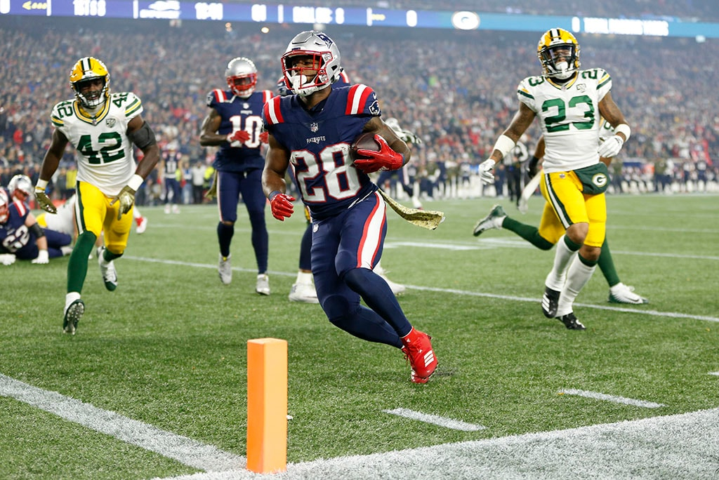 Nov 4, 2018; Foxborough, MA: New England Patriots running back James White rushes for a touchdown during the first quarter against the Green Bay Packers at Gillette Stadium. (Greg M. Cooper-USA TODAY Sports)