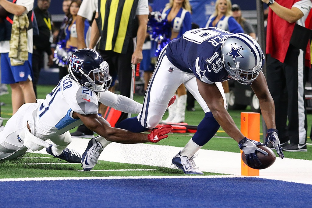 Nov 5, 2018; Arlington, TX: Dallas Cowboys receiver Amari Cooper runs after a reception for a first quarter touchdown against Tennessee Titans cornerback Malcolm Butler (21) at AT&T Stadium. (Matthew Emmons-USA TODAY Sports)