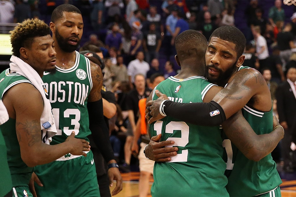 PHOENIX, AZ - NOV. 08, 2018: (R-L) Kyrie Irving, Terry Rozier, Marcus Morris, and Marcus Smart of the Boston Celtics celebrate after defeating the Phoenix Suns at Talking Stick Resort Arena. The Celtics won 116-109 in overtime. (Photo by Christian Petersen/Getty Images)