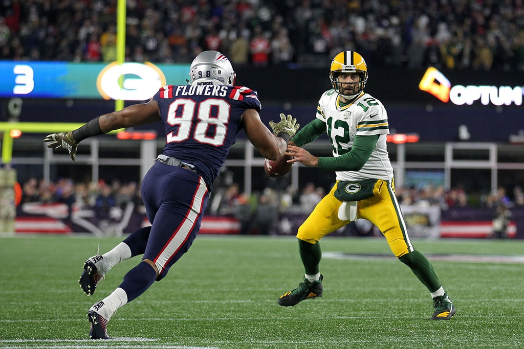 Nov 4, 2018; Foxborough, MA, USA; Green Bay Packers quarterback Aaron Rodgers looks to pass the ball as New England Patriots defensive end Trey Flowers pressures him during the second quarter at Gillette Stadium. (Stew Milne-USA TODAY Sports)