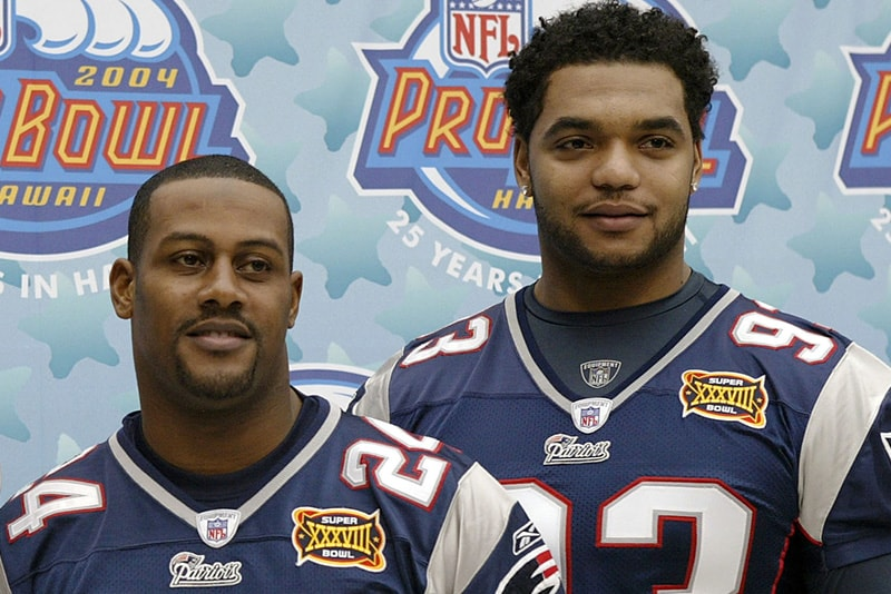 HOUSTON - JANUARY 27:  Pro Bowl selections cornerback Ty Law and defensive lineman Richard Seymour of the New England Patriots pose for a photo on media day January 27, 2003 at Reliant Stadium before Super Bowl XXXVIII against the Carolina Panthers. (Photo by Brian Bahr/Getty Images)