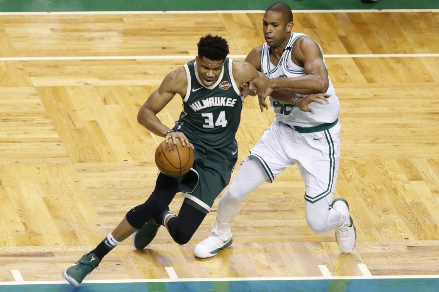 Apr 28, 2018; Boston, MA, USA; Milwaukee Bucks forward Giannis Antetokounmpo (34) controls the ball as Boston Celtics forward Al Horford (42) defends during the first quarter in game seven of the first round of the 2018 NBA Playoffs at TD Garden. Mandatory Credit: Greg M. Cooper-USA TODAY Sports