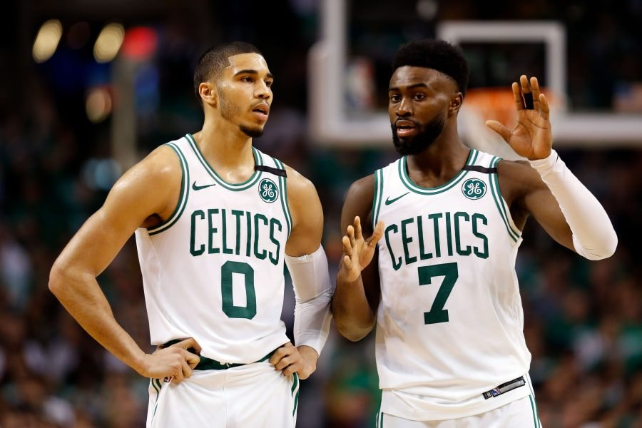May 23, 2018; Boston, MA, USA; Boston Celtics forward Jayson Tatum (0) and Boston Celtics guard Jaylen Brown (7) talk during the third quarter against the Cleveland Cavaliers in game five of the Eastern conference finals of the 2018 NBA Playoffs at TD Garden. Mandatory Credit: Greg M. Cooper-USA TODAY Sports