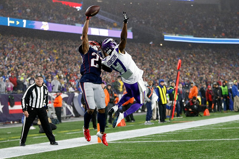 Dec 2, 2018; Foxborough, MA: New England Patriots cornerback J.C. Jackson attempts to intercept a pass intended for Minnesota Vikings wide receiver Aldrick Robinson during the third quarter at Gillette Stadium. (Greg M. Cooper-USA TODAY Sports)