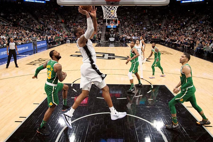 Dec 31, 2018; San Antonio, TX: San Antonio Spurs power forward LaMarcus Aldridge shoots the ball as Boston Celtics power forward Marcus Morris (left) and Jayson Tatum (right) look on during the second half at AT&T Center. (Soobum Im-USA TODAY Sports)