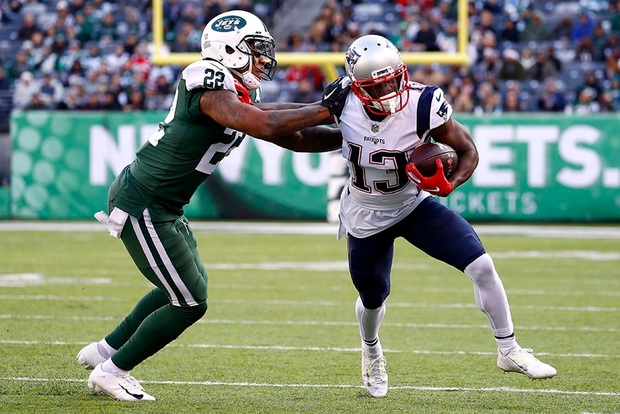 EAST RUTHERFORD, NEW JERSEY - NOVEMBER 25: Phillip Dorsett of the New England Patriots is tackled by Trumaine Johnson of the New York Jets during the fourth quarter at MetLife Stadium. (Photo by Jeff Zelevansky/Getty Images)
