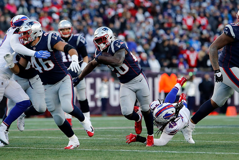 Dec 23, 2018; Foxborough, MA: New England Patriots running back Sony Michel (26) runs the ball against the Buffalo Bills in the third quarter at Gillette Stadium. (David Butler II-USA TODAY Sports)