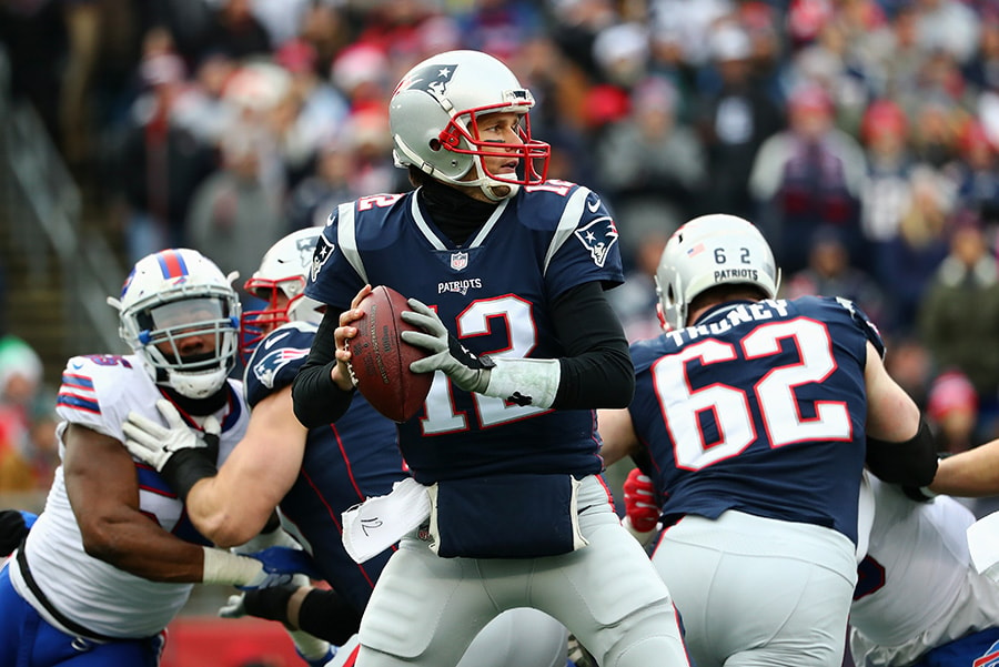 FOXBORO, MA - DECEMBER 24: Tom Brady of the New England Patriots looks to pass against the Buffalo Bills at Gillette Stadium. (Photo by Tim Bradbury/Getty Images)