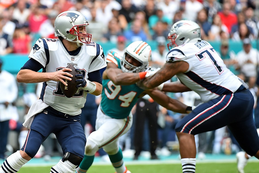 Dec 9, 2018; Miami Gardens, FL: New England Patriots quarterback Tom Brady attempts a pass against the Miami Dolphins during the first half at Hard Rock Stadium. (Jasen Vinlove-USA TODAY Sports)