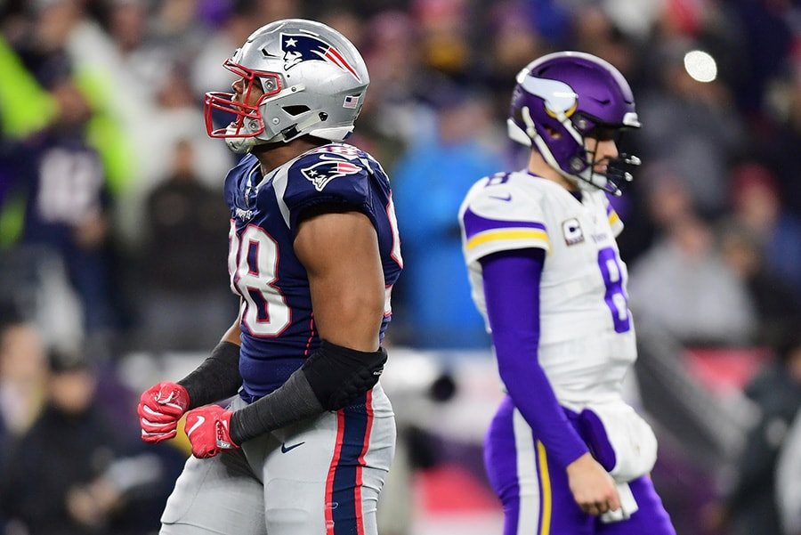 FOXBOROUGH, MA - DECEMBER 02: Trey Flowers of the New England Patriots reacts in front of Kirk Cousins of the Minnesota Vikings during the second half at Gillette Stadium. The Patriots beat the Vikings 24-10. (Photo by Billie Weiss/Getty Images)