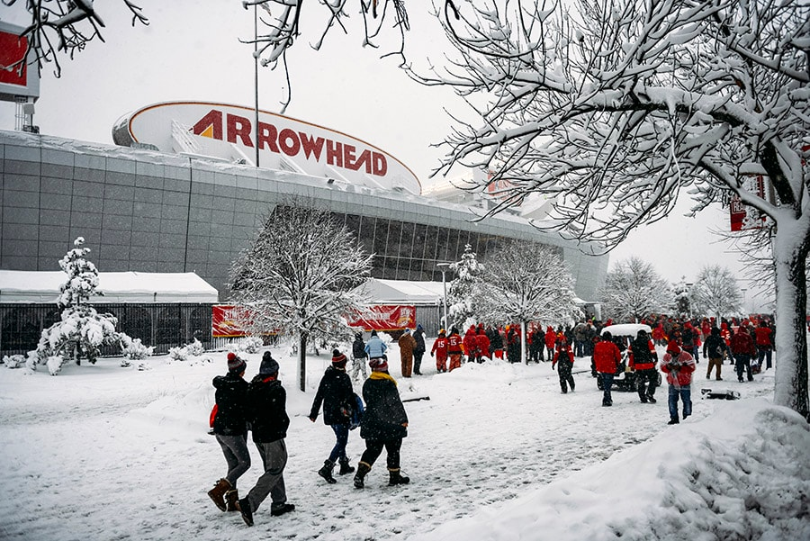 KANSAS CITY, MO - JANUARY 12: Kansas City Chiefs fans walk through the parking lot prior to the AFC Divisional Round playoff game between the Kansas City Chiefs and the Indianapolis Colts at Arrowhead Stadium. (Photo by Jason Hanna/Getty Images)