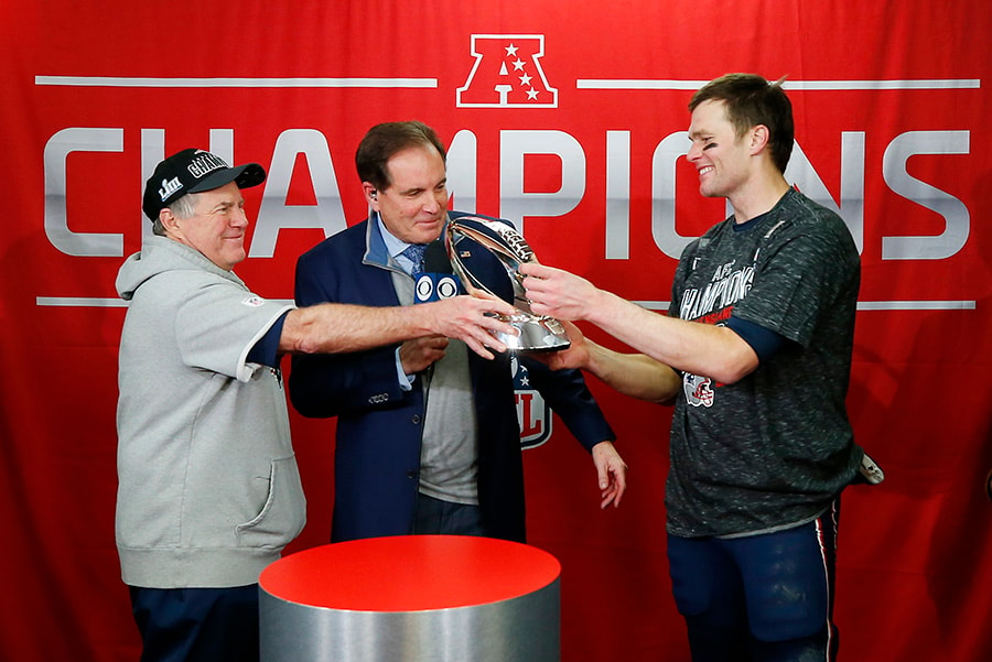 KANSAS CITY, MISSOURI - JANUARY 20: Head coach Bill Belichick of the New England Patriots hands the Lamar Hunt Trophy to Tom Brady after defeating the Kansas City Chiefs during the AFC Championship Game at Arrowhead Stadium. (Photo by Jamie Squire/Getty Images)