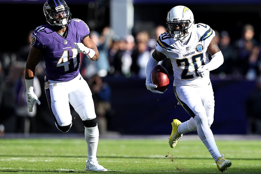 BALTIMORE, MARYLAND - JANUARY 06: Desmond King of the Los Angeles Chargers returns the ball against the Baltimore Ravens during the first quarter in the AFC Wild Card Playoff game at M&T Bank Stadium. (Photo by Patrick Smith/Getty Images)
