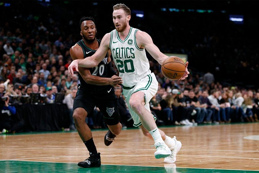 Jan 2, 2019; Boston, MA: Boston Celtics forward Gordon Hayward dribbles the ball past Minnesota Timberwolves guard Josh Okogie during the second half at TD Garden. (Greg M. Cooper-USA TODAY Sports)