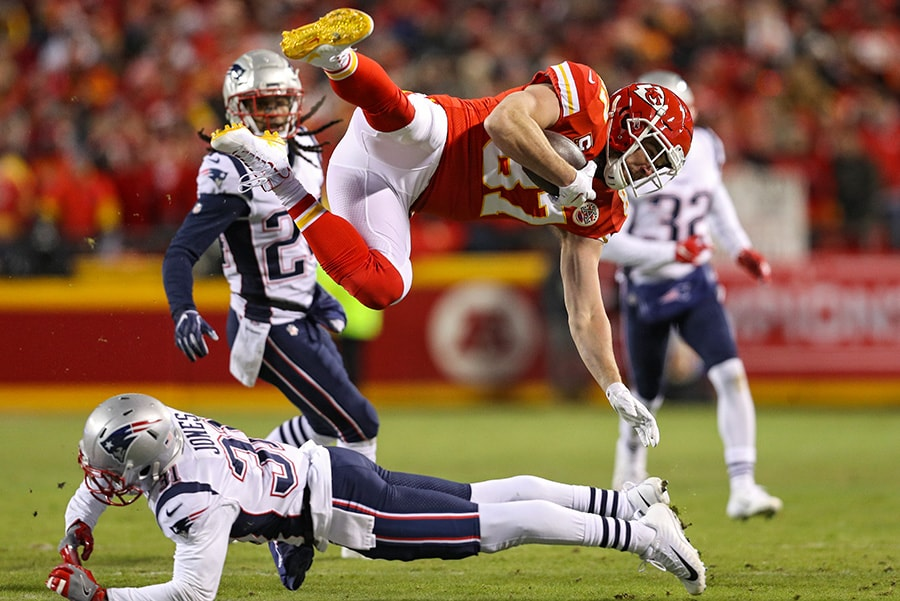 KANSAS CITY, MISSOURI - JANUARY 20: Travis Kelce #87 of the Kansas City Chiefs is tackled by Jonathan Jones #31 of the New England Patriots in the first half during the AFC Championship Game at Arrowhead Stadium on January 20, 2019 in Kansas City, Missouri. (Photo by Patrick Smith/Getty Images)