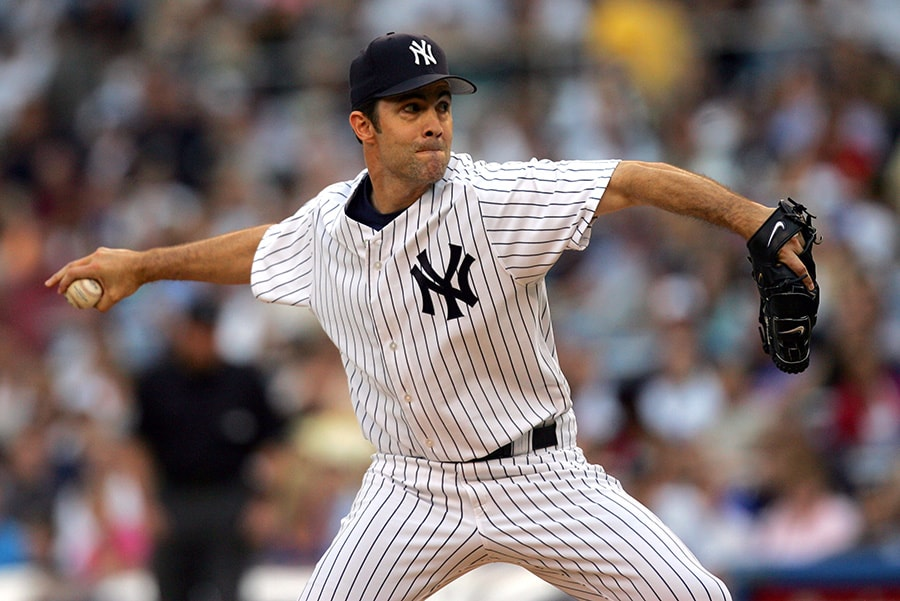 Mike Mussina of the New York Yankees pitches to the New York Mets at Yankee Stadium. (Photo by Chris Trotman/Getty Images)