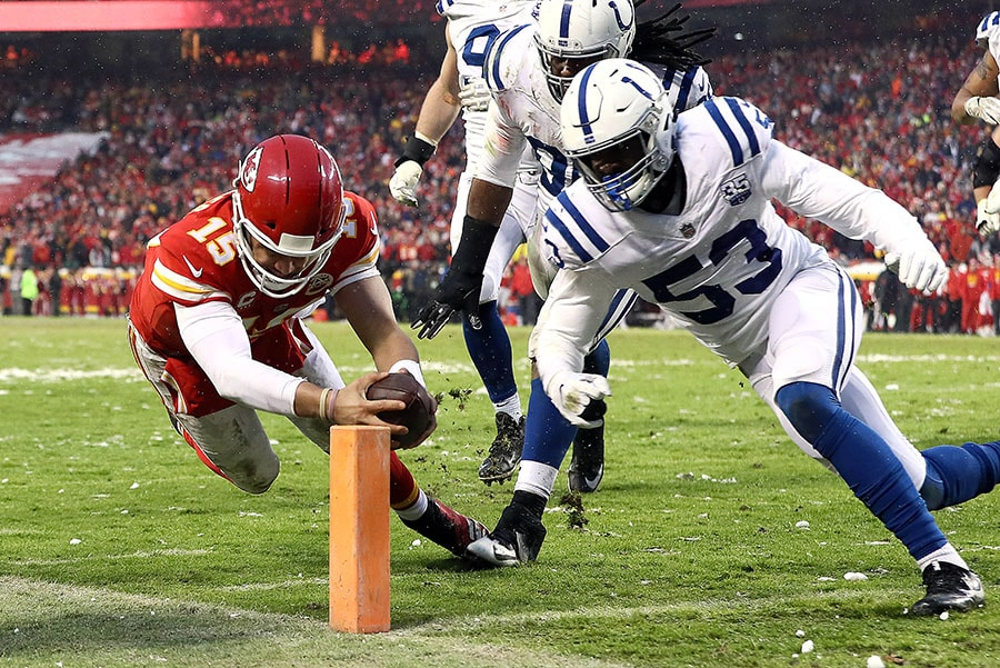 KANSAS CITY, MISSOURI - JANUARY 12: Patrick Mahomes of the Kansas City Chiefs dives for the endzone for a touchdown as Darius Leonard #53 of the Indianapolis Colts defends during the AFC Divisional round playoff game at Arrowhead Stadium. (Photo by Jamie Squire/Getty Images)