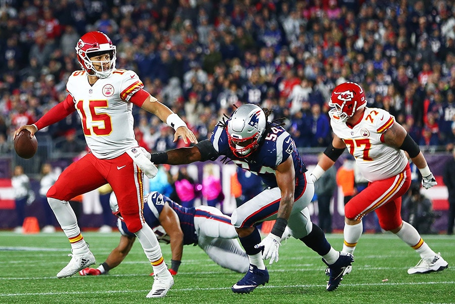 FOXBOROUGH, MA - OCTOBER 14: Patrick Mahomes of the Kansas City Chiefs looks to pass in the second quarter of a game against the New England Patriots at Gillette Stadium. (Photo by Adam Glanzman/Getty Images)