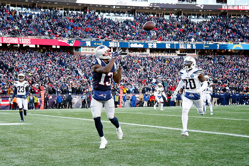 Jan 13, 2019; Foxborough, MA, USA; New England Patriots wide receiver Phillip Dorsett (13) catches a pass for a touchdown in front of Los Angeles Chargers defensive back Desmond King (20) during the second quarter in an AFC Divisional playoff football game at Gillette Stadium. Mandatory Credit: Winslow Townson-USA TODAY Sports
