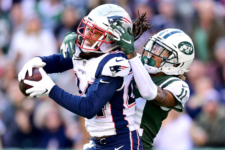 EAST RUTHERFORD, NEW JERSEY - NOVEMBER 25: Stephon Gilmore of the New England Patriots intercepts a pass intended for Robby Anderson #11 of the New York Jets during the second quarter at MetLife Stadium. (Photo by Sarah Stier/Getty Images)