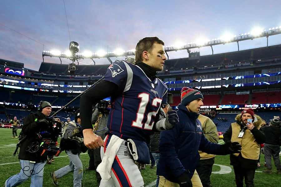 FOXBOROUGH, MASSACHUSETTS - JANUARY 13: Tom Brady of the New England Patriots runs off the field following in the AFC Divisional Playoff Game against the Los Angeles Dodgers at Gillette Stadium. (Photo by Maddie Meyer/Getty Images)