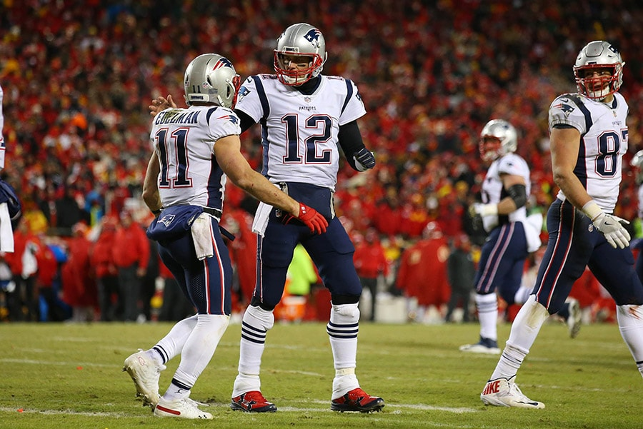 Jan 20, 2019; Kansas City, MO, USA; New England Patriots quarterback Tom Brady (12) celebrates with Patriots wide receiver Julian Edelman (11) during the second half of the AFC Championship game against the Kansas City Chiefs at Arrowhead Stadium. Mandatory Credit: Jay Biggerstaff-USA TODAY Sports