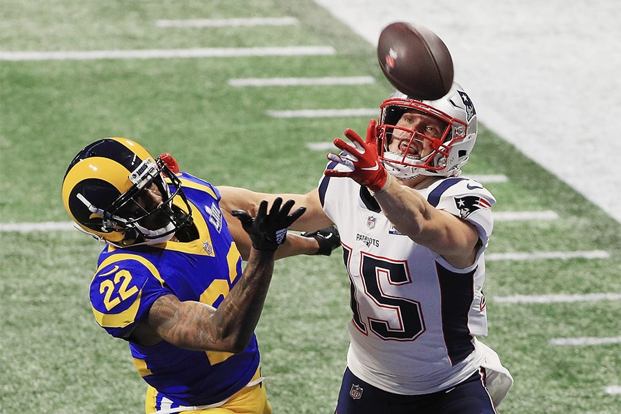 ATLANTA, GA - FEBRUARY 03: Los Angeles Rams's Marcus Peters defends a pass against Chris Hogan of the New England Patriots in the first half of the Super Bowl LIII at the Mercedes-Benz Stadium. (Photo by Mike Ehrmann / Getty Images)