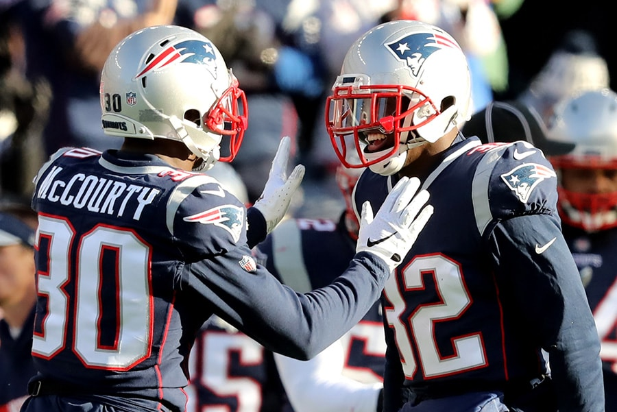 FOXBOROUGH, MASSACHUSETTS - JANUARY 13: Jason McCourty of the New England Patriots and Devin McCourty react during the second quarter in the AFC Divisional Playoff Game against the Los Angeles Chargers at Gillette Stadium. (Photo by Elsa/Getty Images)