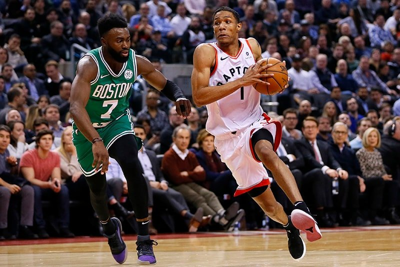 Feb 26, 2019; Toronto, Ontario, CAN: Toronto Raptors guard Patrick McCaw drives to the basket against Boston Celtics guard Jaylen Brown during the first half at Scotiabank Arena. (John E. Sokolowski-USA TODAY Sports)