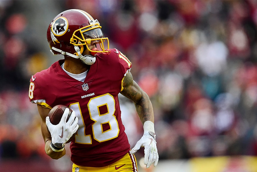 LANDOVER, MD - DECEMBER 24: Wide receiver Josh Doctson of the Washington Redskins scores a touchdown against the Denver Broncos in the fourth quarter at FedExField. (Photo by Patrick McDermott/Getty Images)