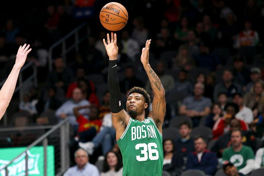 Jan 19, 2019; Atlanta, GA: Boston Celtics guard Marcus Smart shoots against the Atlanta Hawks in the third quarter at State Farm Arena. (Brett Davis-USA TODAY Sports)