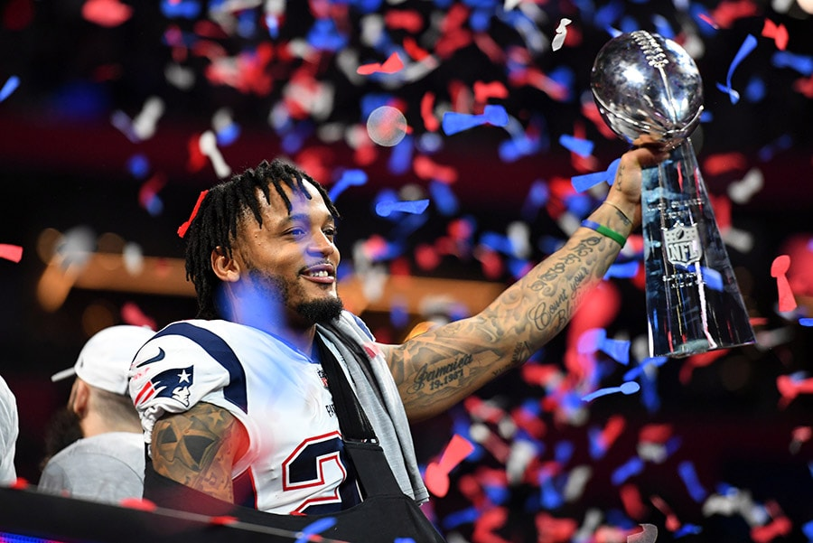 Feb 3, 2019; Atlanta, GA: New England Patriots strong safety Patrick Chung raises the Vince Lombardi Trophy after winning Super Bowl LIII against the Los Angeles Rams at Mercedes-Benz Stadium. (Christopher Hanewinckel-USA TODAY Sports)