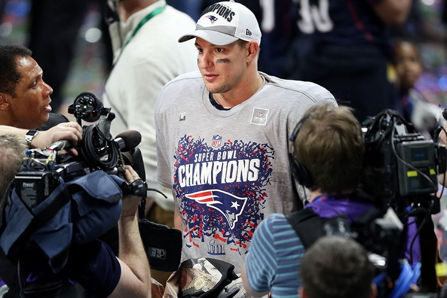 ATLANTA, GEORGIA - FEBRUARY 03: Rob Gronkowski of the New England Patriots is interviewed after his teams 13-3 win over the Los Angeles Rams during Super Bowl LIII at Mercedes-Benz Stadium. (Photo by Patrick Smith/Getty Images)