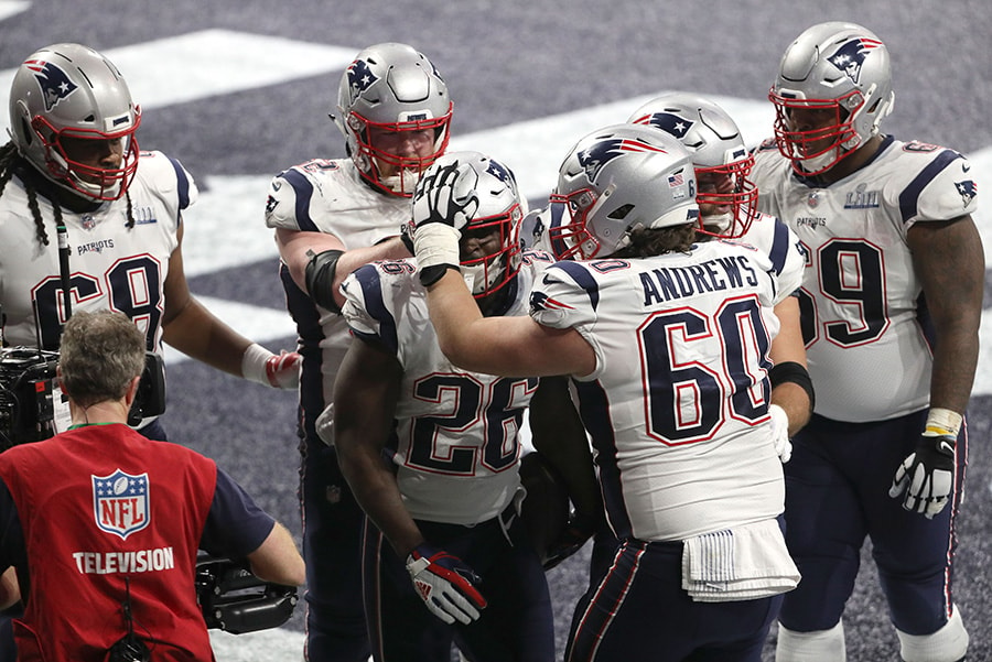 ATLANTA, GEORGIA - FEBRUARY 03: David Andrews and James Develin congratulate Sony Michel of the New England Patriots after his fourth quarter touchdown against Los Angeles Rams during Super Bowl LIII at Mercedes-Benz Stadium. (Photo by Patrick Smith/Getty Images)
