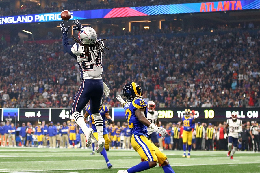 Feb 3, 2019; Atlanta, GA: New England Patriots cornerback Stephon Gilmore intercepts a pass intended for Los Angeles Rams wide receiver Brandin Cooks in the fourth quarter in Super Bowl LIII at Mercedes-Benz Stadium. (Mark J. Rebilas-USA TODAY Sports)
