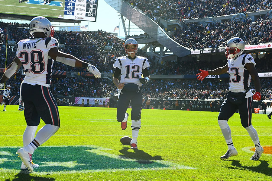 Oct 21, 2018; Chicago, IL: New England Patriots quarterback Tom Brady and running back James White and wide receiver Phillip Dorsett react after a touchdown during the first half at Soldier Field. (Mike DiNovo-USA TODAY Sports)
