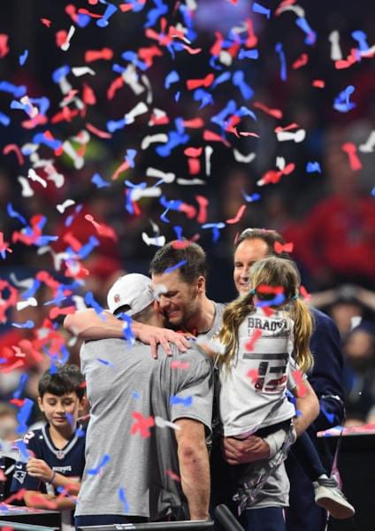 Feb 3, 2019; Atlanta, GA, USA; New England Patriots wide receiver Julian Edelman (left) and quarterback Tom Brady (middle) and Brady's daughter Vivian (right) celebrate after defeating the Los Angeles Rams in Super Bowl LIII at Mercedes-Benz Stadium. Mandatory Credit: John David Mercer-USA TODAY Sports