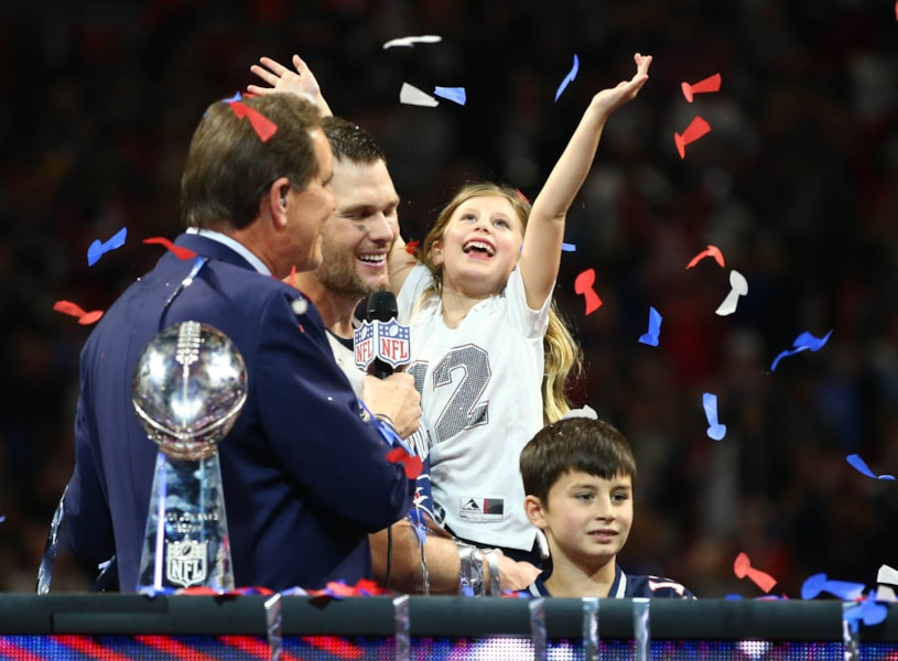 Feb 3, 2019; Atlanta, GA, USA; New England Patriots quarterback Tom Brady (12) and daughter Vivian celebrate as they are interviewed by CBS host Jim Nantz after Super Bowl LIII against the Los Angeles Rams at Mercedes-Benz Stadium. Mandatory Credit: Mark J. Rebilas-USA TODAY Sports