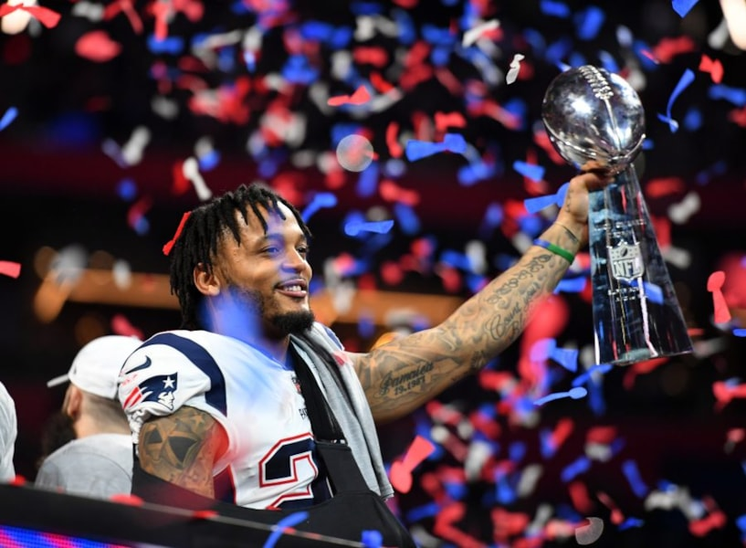 Feb 3, 2019; Atlanta, GA, USA; New England Patriots strong safety Patrick Chung (23) raises the Vince Lombardi Trophy after winning Super Bowl LIII against the Los Angeles Rams at Mercedes-Benz Stadium. Mandatory Credit: Christopher Hanewinckel-USA TODAY Sports