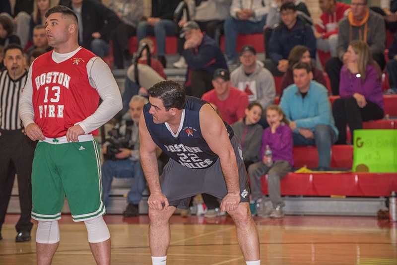 Boston police and fire department reps play in the annual Battle of the Badges charity basketball game, an event created by the A Shot For Life organization. (Courtesy Mike Slonina)
